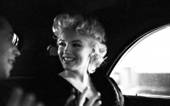 NEW YORK - MARCH 30: Actress Marilyn Monroe rides in the back of a car with Dick Shepherd on March 30, 1955 in New York City, New York. (Photo by Ed Feingersh/Michael Ochs Archives/Getty Images)
