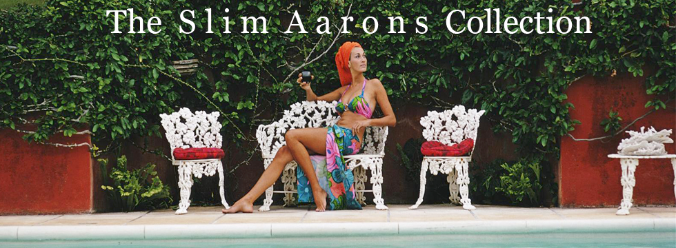 Note this image is available as an Open Edition or Limited Edition Estate Stamped Print (edition size 1/150). A woman relaxes with a drink by a swimming pool in Bermuda, November 1969. Photo by Slim Aarons