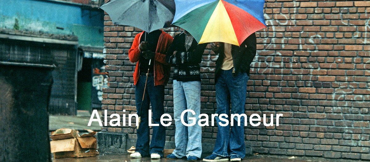 USA, HARLEM, NEW YORK CITY- APRIL 1978. Harlem residents hiding their faces with umbrellas, New York City. Photograph Alain Le Garsmeur NB all prints are produced as limited edtion (ed. 1/100) C Type prints and are stamped & numbered on the front.