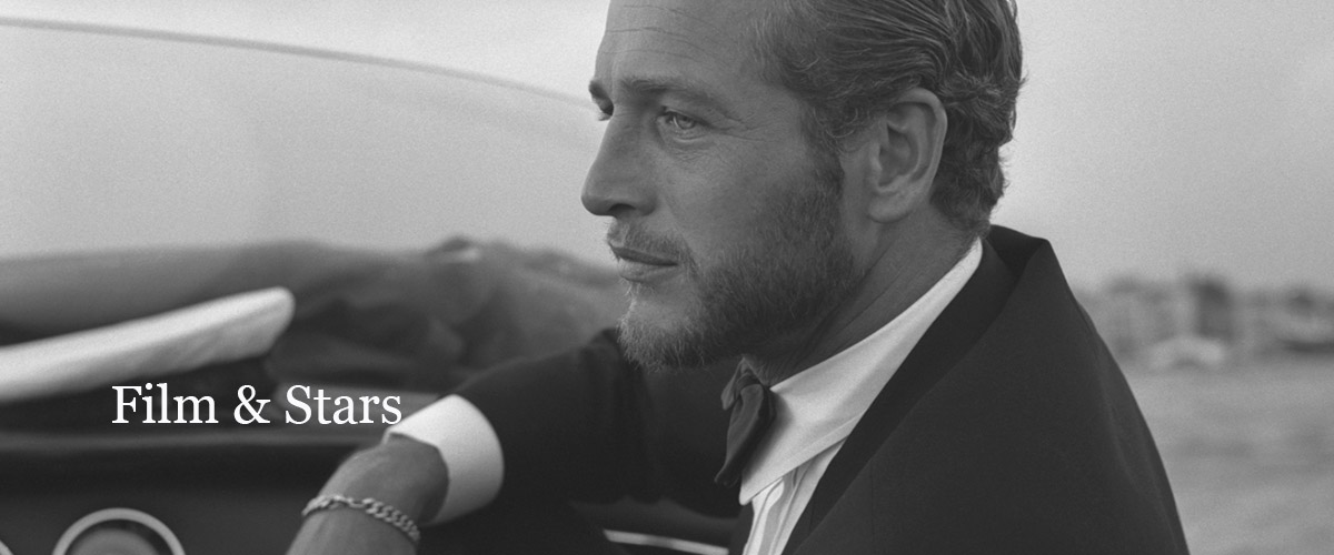 Actor Paul Newman on a riva motorboat in venice during the film festival there in 1963 wearing a tuxedo and sporting a fashionable beard.