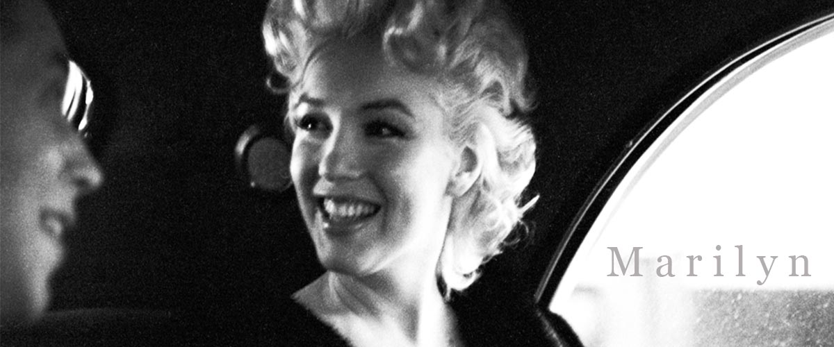 Actress and iconic sex symbol Marilyn Monroe rides in the back of a car with Dick Shepherd on March 30, 1955 in New York City, New York. (Photo by Ed Feingersh)