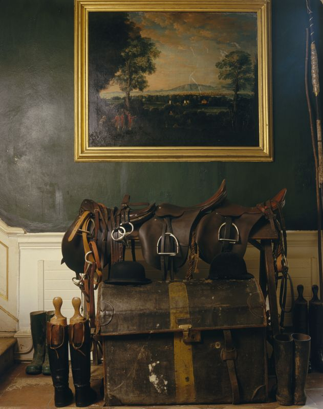 An oil painting, various saddles and an old trunk in Leixlip Castle, County Kildare, 1990s. (Photo by Christopher Simon Sykes/Hulton Archive/Getty Images)