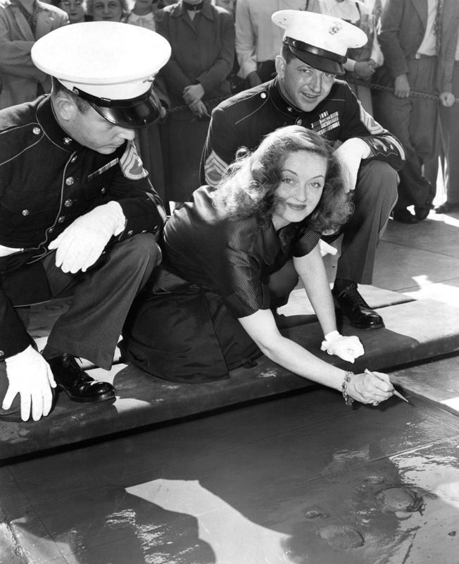 Bette Davis Making Her Mark At Graumans Chinese Theatre
