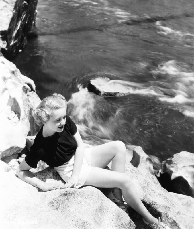 Bette Davis Models Beside A Flowing River