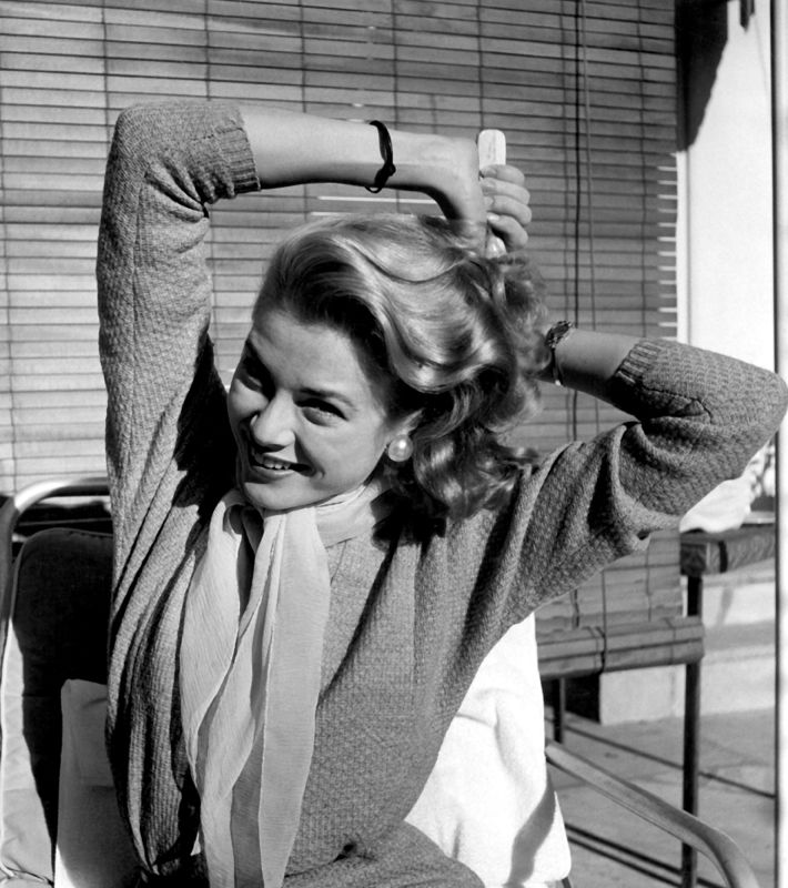 Grace Kelly Grooming Her Hair