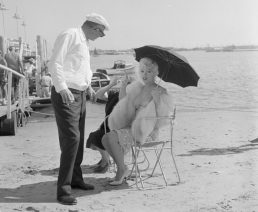 Marilyn Monroe Shading Herself on a Beach