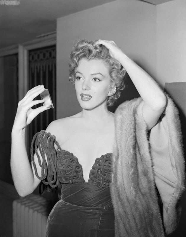 Monroe Fixes Her Hair